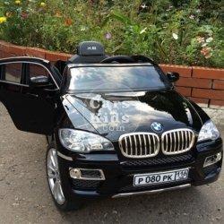 Электромобиль BMW X6 черный (колеса резина, кресло кожа, пульт, музыка, глянцевая покраска)
